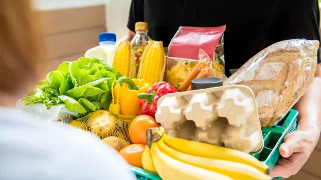 wiping-grocery-items-with-a-cloth